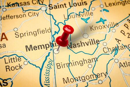 PRAGUE, CZECH REPUBLIC - JANUARY 12, 2019: Red thumbtack in a map. Pushpin pointing at Memphis city in Tennessee, America.