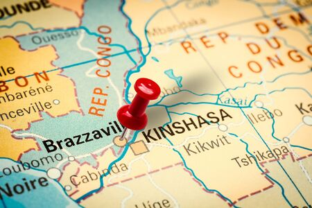 PRAGUE, CZECH REPUBLIC - JANUARY 12, 2019: Red thumbtack in a map. Pushpin pointing at Brazzaville city in Congo.