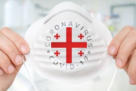 Respirator mask with flag of Georgia - Coronavirus COVID-19 epidemic concept Reklamní fotografie