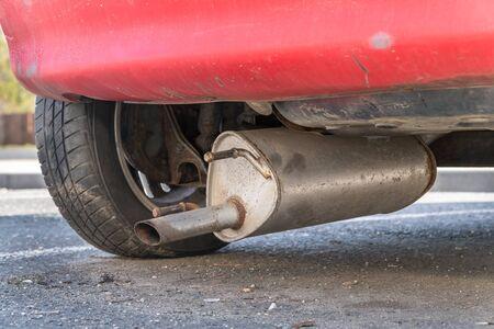 Car exhaust (muffler) fallen off a car - forgotten car on street concept 版權商用圖片