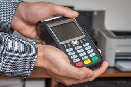 Payment terminal in hand of man