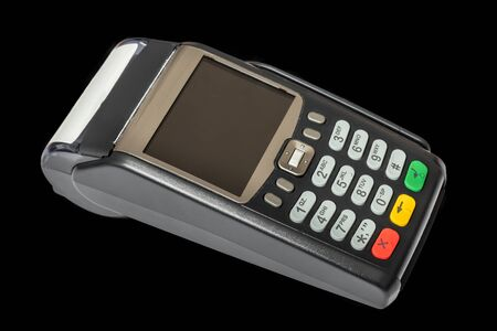 Payment terminal isolated on black background
