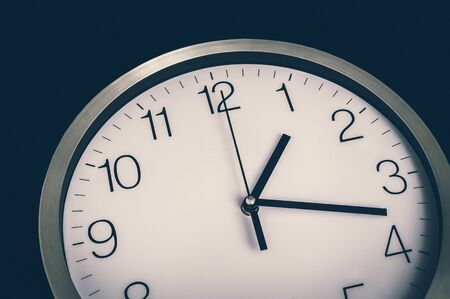 Close-up view of clock isolated on black - deadline and time concept - retro style 스톡 콘텐츠