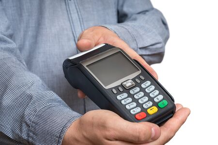 Payment terminal in hand of man isolated on white background