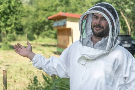 Beekeeper with his bee hive