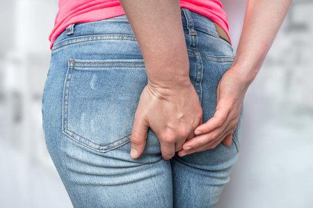 Woman suffers from diarrhea, she holding her butt - diarrhea concept