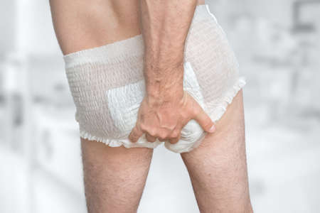 Man wearing incontinence diaper - urinary incontinence concept