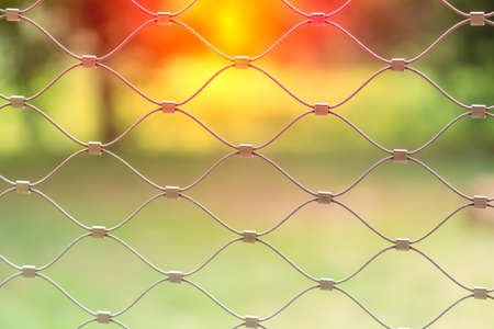 Braided wire fence - close-up photography isolated on green background Stockfoto