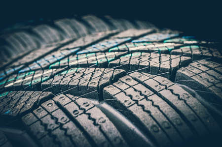 Winter car tires isolated on black background - retro style