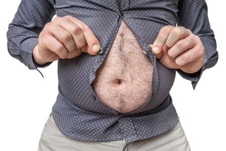 Fat belly of man which does not fit under the shirt isolated on white - obesity concept