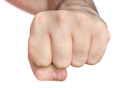 Fist of man isolated on white background - aggression and power symbol Standard-Bild