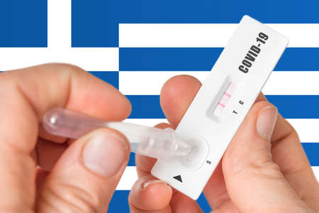 Positive rapid test on COVID-19 in Greece on background of national flag Stok Fotoğraf