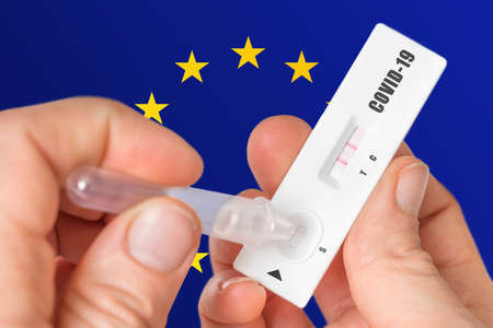 Positive rapid test on COVID-19 in European Union on background of national flag