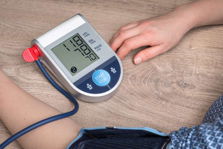 Blood pressure monitor with normal pressure level on screen Stok Fotoğraf