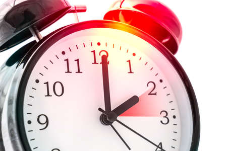 Alarm clock with double bell - winter time and summer time concept