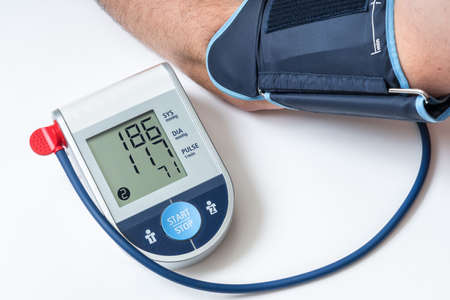Blood pressure monitor with high pressure level on screen - hypertension concept Stok Fotoğraf