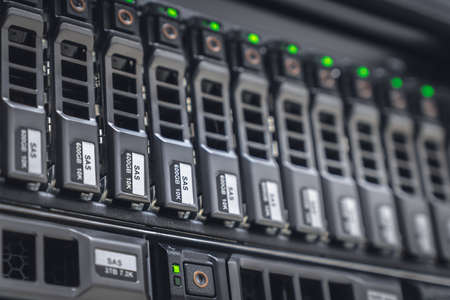 Storage server with many HDD disks inside rack in server room - data center concept