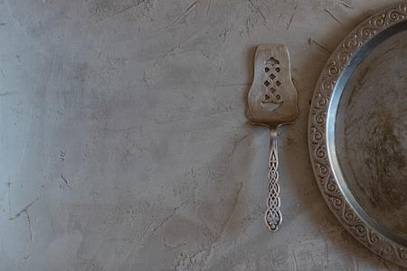 vintage tableware on empty cement grey background