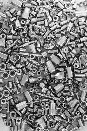 Much of screws on the cement surface, black and white for textured background or wallpaper