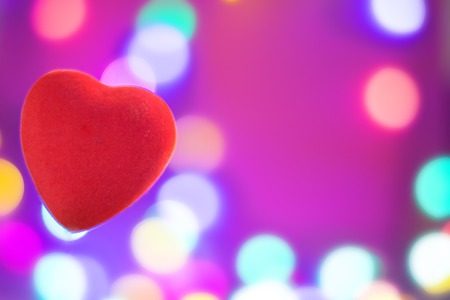 Bright red heart on blurred background, festive background or postcard for Valentines day with copy space Banco de Imagens