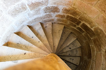 Old Spiral stairs of ancient castle made from stones, top view, horizontal, mediterranean, cyprus, architecture, golden spiral
