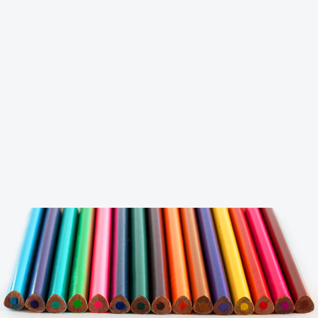 Many Pecils of different colors on white empty background, Selective focus, Triangular pencil as neuropsychological method for right whriting position, Square with copy space for text and desigh