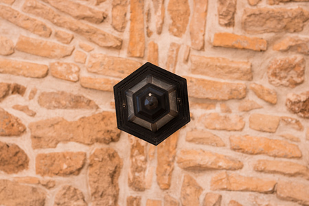 Black Lamp in chirch gallery in the center of orange stone seiling background, symmetry, architecture, cyprus, st. Lazarus, Larnaca
