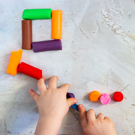 Colorful clay plasticine, modelling clay placed like square with child's hands, square, education, child psychology, neuropsychology fine motor skills manual dexterity mental health copy space