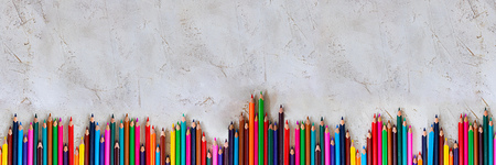Many Pecils of different colors on cement grey background, Kid, Children, Education, Art, Drawing, Graphic, Diagonal, Empty space for text Copy space, Long horizontal banner