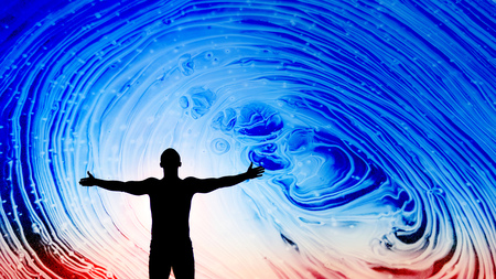 black silhouette of man with opened hands under beautiful bright blue and red abstract space sky. Space concept, Human as Universe explorer, copy space background for text and design