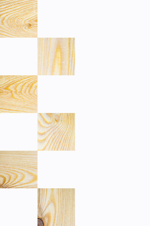 Light textured wooden square blocks in chess board order on white background, Vertical with copy space for text and design about wood work and natural timber