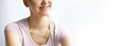 Red bubbles of virus herpes on lips of a woman in light pink t-shirt, lower part face is seen, lady is smiling. Medicine, treatment. Long horizontal banner with copy space. White background