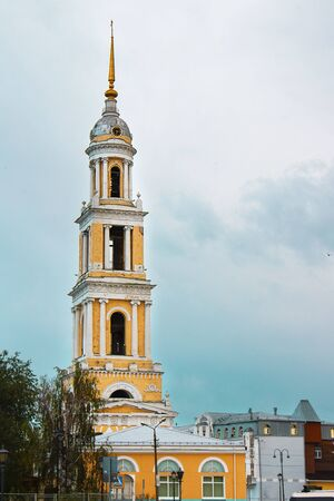 Bell tower of John the Apostle Church, a part of Kolomna kremlin, Golden Ring of Russia. on the background of cloudy sky. Vertical with copy space 스톡 콘텐츠