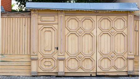 Beautifull ate and door, wicket and fence. Tall painted barrier. Russian style. Wooden architecture. Horizontal