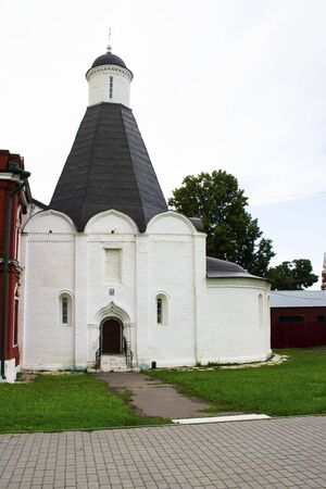 Ancient Uspensky brusensky monastery in Kolomna, a part of Kremlin complex. Small church with black triangle roof. Russian Orthodox, Religion, traditions and history. Travelling. Vertical
