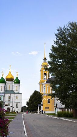 View on Kolomna street with bell tower of John the Apostle and Archangel Michael Church, Kolomna kremlin. Sightseeing and travelling in Russia. History, Religion, Vertical banner