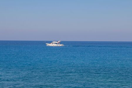 White ship on amazing bright blue green sea and sunny day. Horizontal with copy space