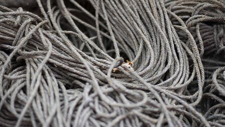 Rough Cord made from natural plant fiber. Rope detail, closeup. Wallpaper and background about fabtic manufacture, eco friendly material. Horizontal. Grey tone. Copy space. Banner