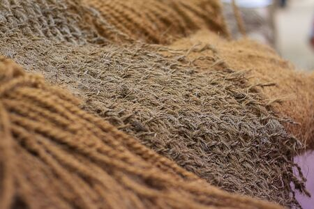 natural Cord and Rough material. Rope detail, closeup. Horizontal. Wallpaper and background about fabtic manufacture, eco friendly material. Selective focus. Brown tone. Copy space.