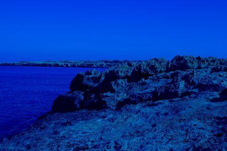 Beautiful landscape near of Nissi beach and Cavo Greco in Ayia Napa, Cyprus island, Mediterranean Sea. Horizontal Amazing sea and evening. Classic, blue monochrome, trend 2020