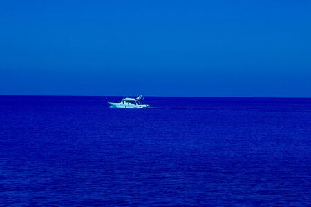 White ship on amazing bright sea. Classic, blue monochrome, trend 2020. Horizontal with copy space. Reklamní fotografie