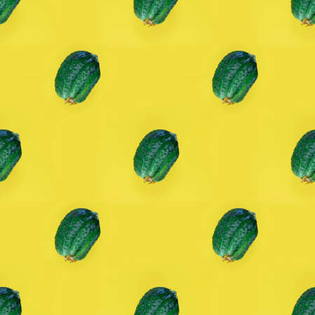 Photographic collage. Seamless pattern with Fresh Ugly triple green organic cucumber, Vegetable with unusual shape on yellow empty background. Eco trend. Buying imperfect product to reduce food waste.