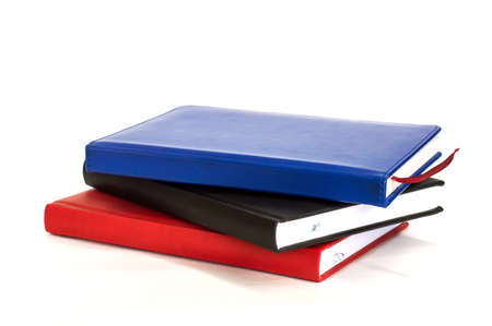 three address books are stacked on each other on white background Stock Photo