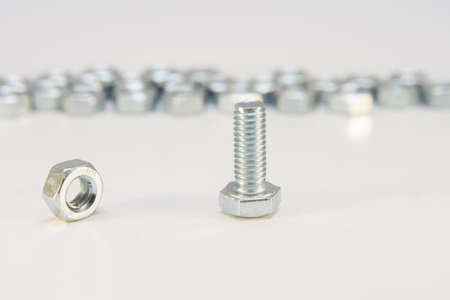Stainless steel bolt and nut, a shop floor item, shallow DOF