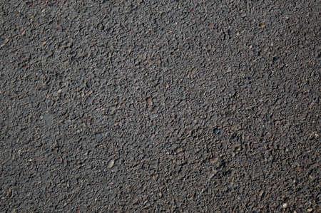 Smooth asphalt road. The texture of the tarmac, top view. Foto de archivo