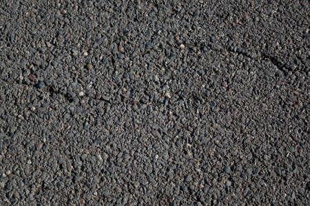 Route goudronnée lisse. La texture du tarmac, vue de dessus.