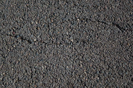 Smooth asphalt road. The texture of the tarmac, top view.
