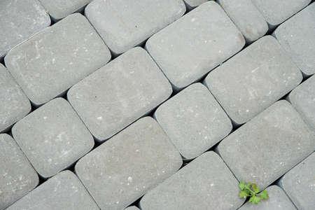 Paving stones. Concept of laying paving slabs and pavers. Paving stones. Concrete pavement blocks Stockfoto