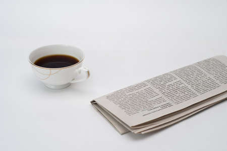 fresh coffee mug and new newspaper white background, top view, layout,