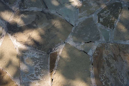 texture paths of stones close-up, footpath from natural stone